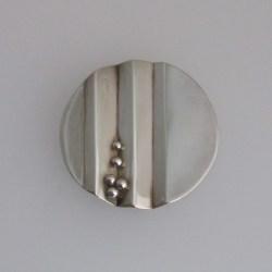 Round silver pendant.