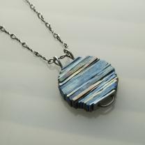 Titanium pendant, silver chain